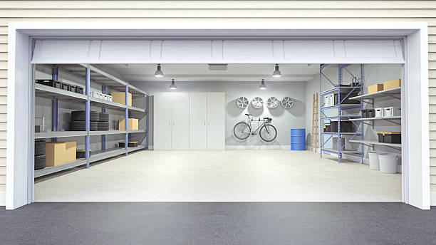 Modern empty garage interior viewing from outside of the open garage door.