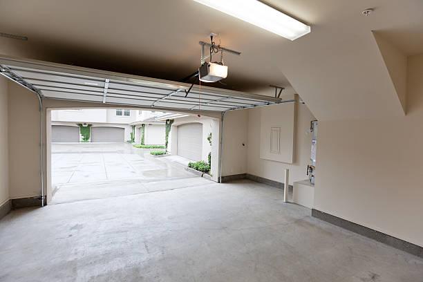 Empty garage with open door, looking from inside